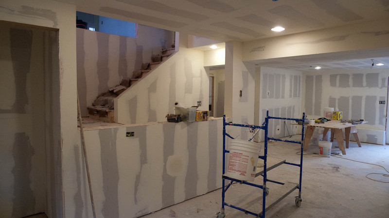 Bottom floor, standing in eating/kitchen area looking at stairs to top floor