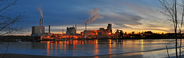 """Old Town Fuel & Fiber Mill, taken from across Penobscot River in Bradley, Maine as the last of the ice was going out.  Photo info Images: 66 Exposures: 3 Bracketing: 4 stops (±2EV) Rows: 2 Columns: 11 Size: 42 megapixels, 11511 x 3672, 38"""" x 12"""" @ 300dpi, 124MB Field of View: 97 degrees, 19mm focal length Camera: Nikon D70 Lens: Nikon AF-S 24-70mm f/2.8G ED Focal Length: 56mm (84mm equivalent) ISO: 200 Aperture: f/8 Shutter: 1/13sec, 0.3sec, 1.3sec"""
