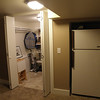 A built in space for the fridge and the door to the closet