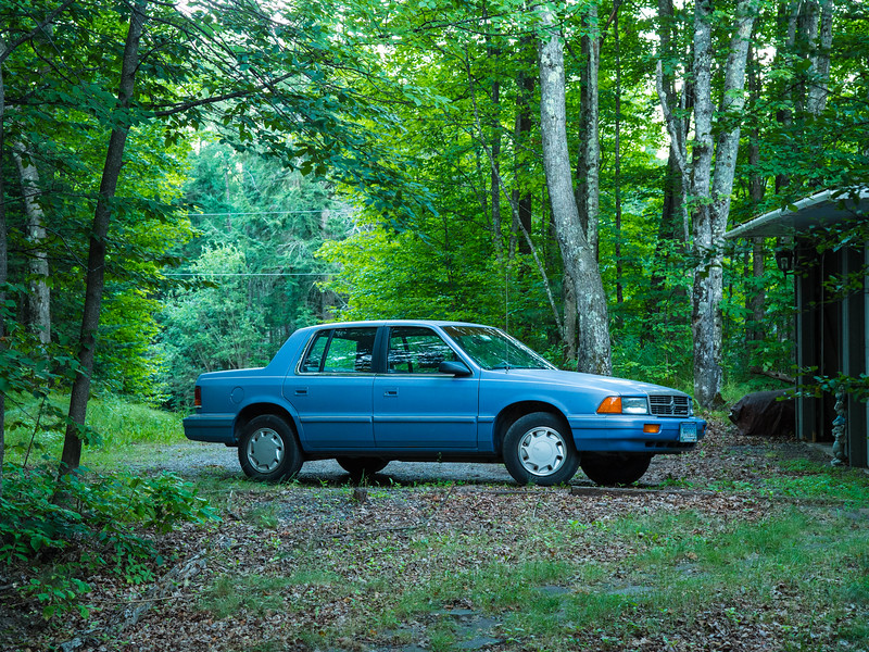 Photographer's very well travelled 1991 Dodge Spirit.