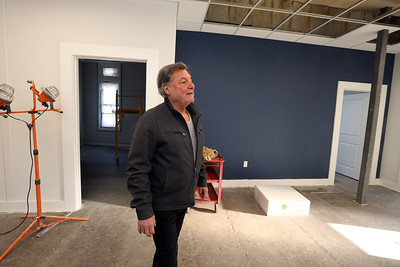 Developer John DeAngelis gives a tour of new office spaces, which will become the Kitson Business Center, after the original name of 491 Dutton Street, and new residential condos. These will be attorney Matt Donahue's offices, one of 15 office spaces in the building. (SUN/Julia Malakie)