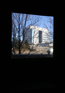 Developer John DeAngelis gives a tour of new office spaces, which will become the Kitson Business Center, after the original name of 491 Dutton Street, and new residential condos. View of the new judicial center from a window. (SUN/Julia Malakie)