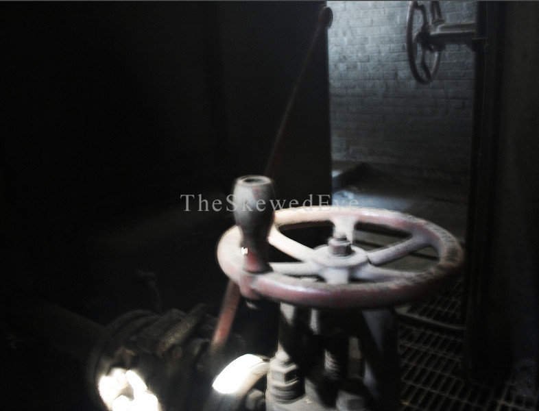 "Boiler Valve - Power Plant Interior<br /> <br /> Again, forgive the blur, I simply could not (sans tripod which I'd left in the SUV, of COURSE) get a decent shot. However, there was something exceedingly creepalicious about this thing, a ""feeeel"" -- it being the only lit up thing in the Power Plant. I included both images as they are, cause I don't know 'bout you, but I STILL ""feeeel"" it when view it."