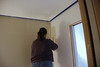 Jennie painting the sink room of our new bathroom.