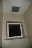 This is the last window box to be dealt with.  Note the freshly painted ceiling and walls.  Also, the fan has its cover in place.  This is the toilet alcove of the new master bath.