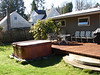 Before: A view of the soon-to-be-smaller deck.  Half of the area occupied by the hot tub will contain a bedroom.
