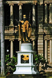 Statue of Kamehameha I in front of Ali'iolani HaleThe first statue of Kamehameha the Great was commissioned by King Kalakaua and created by an American sculptor named Thomas Gould. It was cast Paris in 1880 and shipped from Germany to Honolulu. Unfortunately, the ship carrying it caught fire and sank.The orignal mold used to cast the statue had not been destroyed so a second statue was made and successfully shipped to Honolulu, where it was installed in front of Ali'iolani Hale,  in 1883.The original statue was later recovered from the shipwreck and installed near Kamehameha's birthplace, in Kohala on the island of Hawai'i.Capitol District, Honolulu, Hawai'i