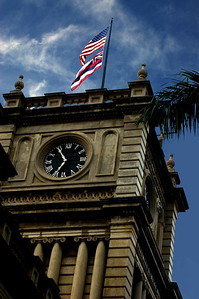 Ali'iolani Hale  Four-storty Clock Tower with the Hawa'iian State flag and the U.S. flag flying overhead.Capitol District, Honolulu, Hawai'i