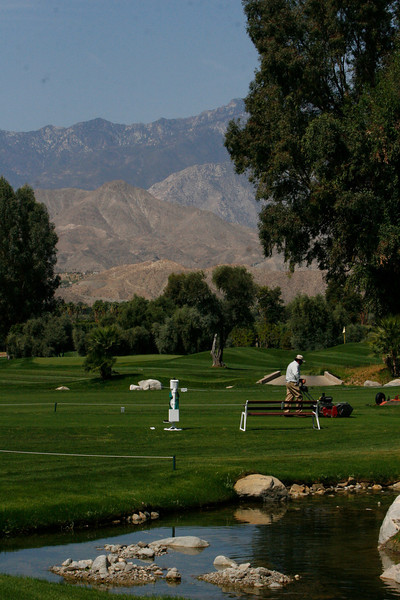 The course was designed so that the tee boxes and the holes on the greens could be quickly changed.  While walter and his guests had lunch in a gazebo the grounds crew would go around and change the tee boxes and holes on the greens for the back nine.