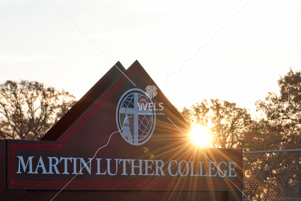Ray of Sun on Martin Luther College Sign by wpekrul