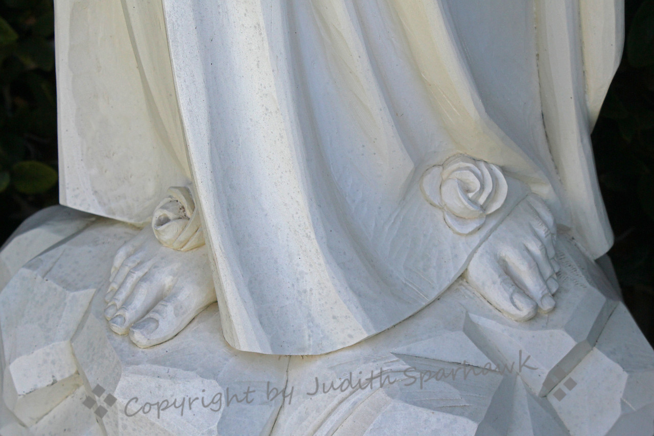 At Her Feet ~ This is detail from a sculpture of Mary in the mission cemetary at San Luis Rey Mission in Oceanside, California.