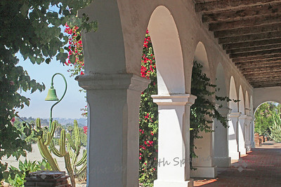 Mission Arches ~ A view down the outer corredor at San Luis Rey Mission in Oceanside, CA.