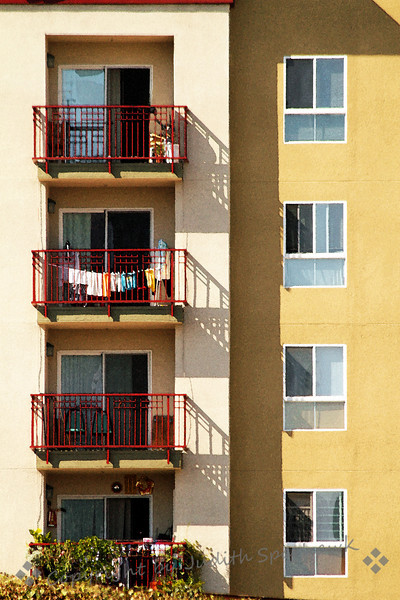 Laundry on the Balcony ~ I liked the graphic nature of these windows and balconies, the shadows that they formed, and the red railings.  The laundry was a bonus.  This building was in Los Angeles, viewed from Chinatown.