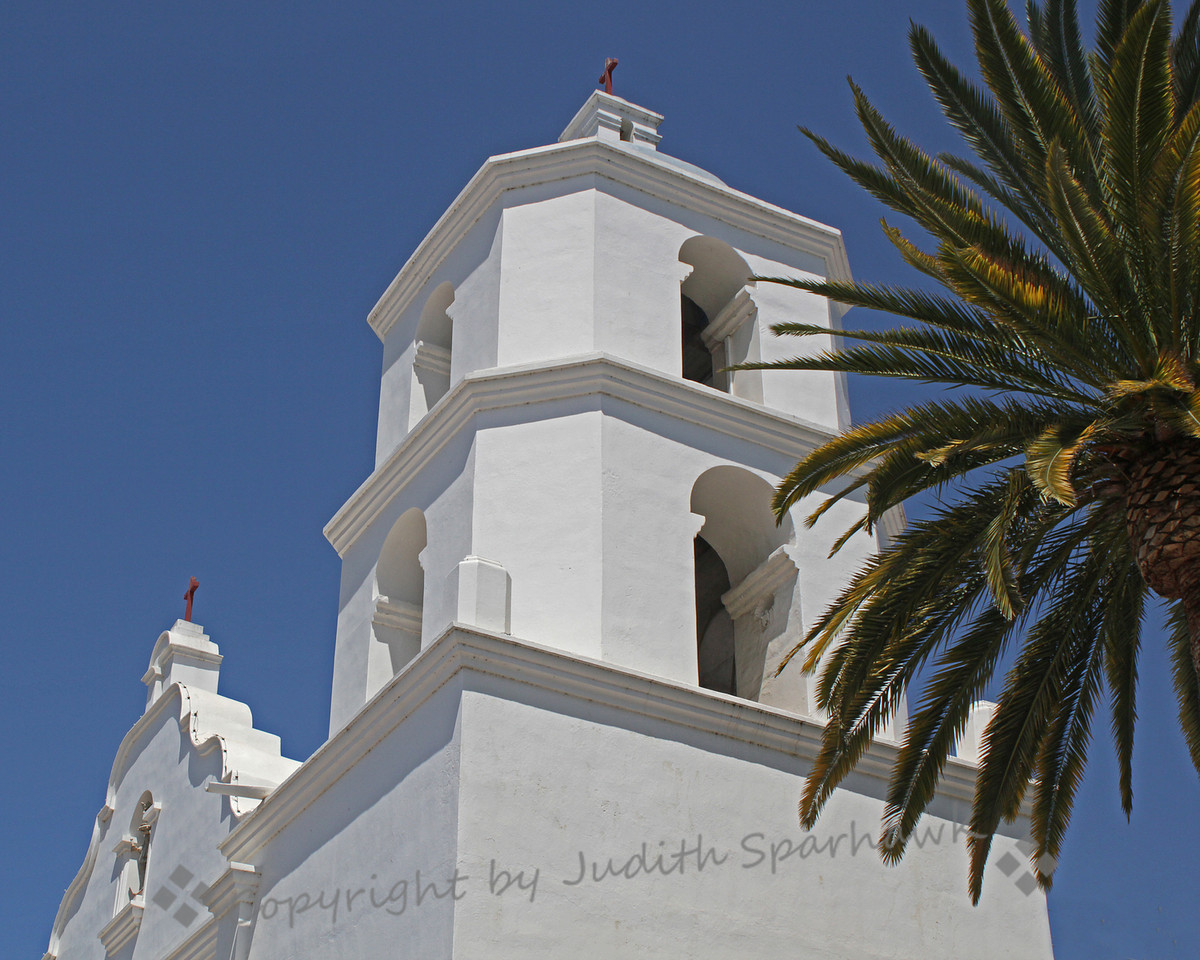 Mission Tower View ~ The distinctive decorative towers of San Luis Rey Mission in Oceanside, California.  This is the largest of the 21 California missions, and has an active order of Friars.