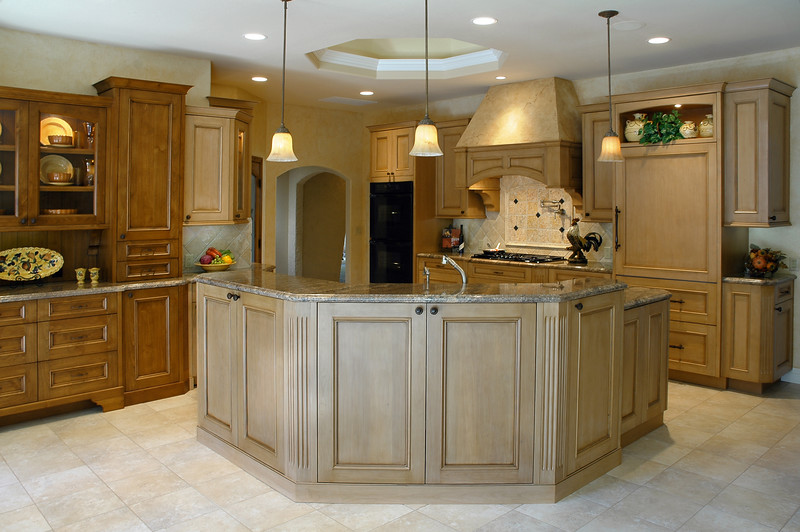 Kitchen with a large island by Cupertino Kitchen Design