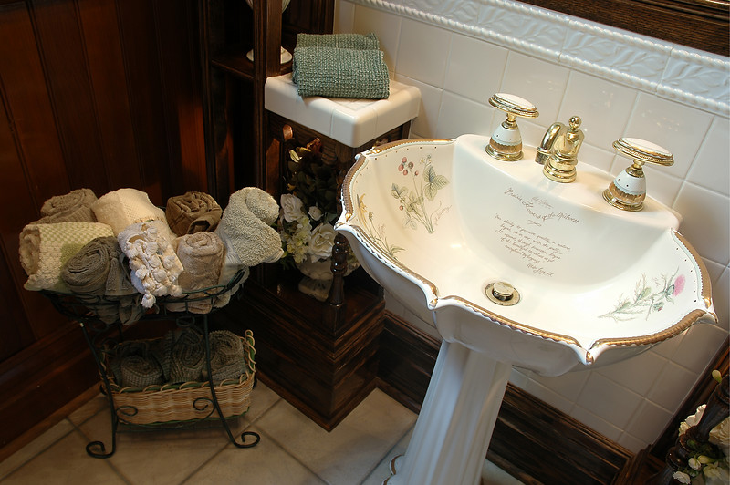 Antique pedestal sink in a Victorian bathroom