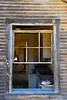 Window to kitchen of abandoned house in Ruby, Arizona.