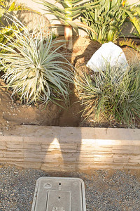 """Trench from meter in front toward house for Main 1"""" water line for Fire Sprinklers, separate 5/8"""" water line to house for water runs from just inside retaining wall across in a straight line to incoming water line bibs at house."""