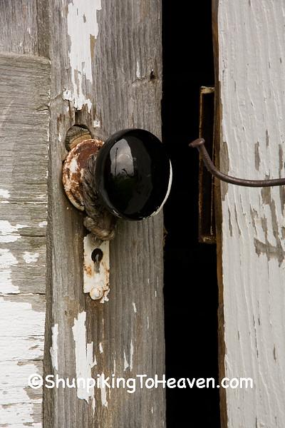 Black Porcelain Doorknob and Peeling Paint, Jones County, Iowa