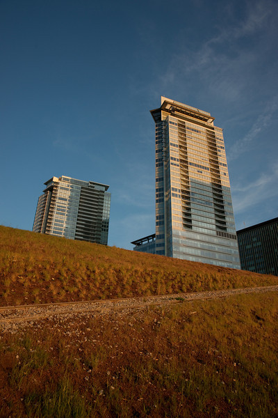 The Shaw Tower, as seen above the green roof on the new Vancouver Convention Centre.