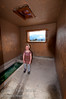 A young girls poses in one of the old Indian Bath Houses at Fairmont Hotsprings.