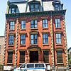 "Former 32nd Precinct Mounted Police Station House, Washington Heights, NYC<br /> <br /> Built in 1871, the former 32nd Precinct Mounted Police Station house at the southwest corner of Amsterdam Avenue  and 152nd Street is a holdout from the days when this area was best known as Carmansville (which is the name of the public playground across the avenue). The so-called ""trans-Harlem"" area of upper Manhattan was a country district where mounted police were a substantial part of the force. The old precinct house is built in the French Second Empire style, its mansard roof with iron cresting still conspicuous above the relatively low-scale streetscape. The building now belongs to a local church."