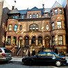 Triple townhouse group at nos. 458-462 West 152nd Street, built in 1890 by C.P. H. Gilbert, Sugar Hill, Harlem