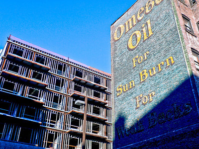 """Vintage Omega Oil painted ad, Harlem  Vintage ad reading """"Omega Oil for Sun Burn for Weak Backs"""" is painted on the side of a Harlem apartment building on West 147th Street, between Frederick Douglas Boulevard and Adam Clayton Powell Boulevard."""