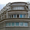 "FEATURED WORK: Dying Slave Redux (Hotel de Police), Paris, 2008<br /> <br /> Finalist -- Photographer´s Forum Magazine's 29th Annual Spring Photography Contest of 2009, and published in the hardcover compendium, ""Best of Photography 2009.""<br /> <br /> This curious building is located on Avenue Daumesnil in Paris's 12th arrondissement, near the Gare de Lyon. It is viewed from the Promenade Plantée, a linear park--like the High Line it inspired in New York City--that converts an ancient elevated railway into a modern greenway. Although the building's showy façade evokes a Hollywood set piece à la Busby Berkeley, it is actually a police headquarters.<br /> <br /> The building's atlantes figures are replicas of ""The Dying Slave,"" a statue by Michelangelo, whose original is in the city's Louvre Museum."