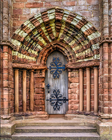 I was attracted to the rich array of textures - the weathered sandstone, wood and metal - of the front doors of St Magnus Cathedral.<br /> <br /> This image was made by merging 5 separate exposures of the door.