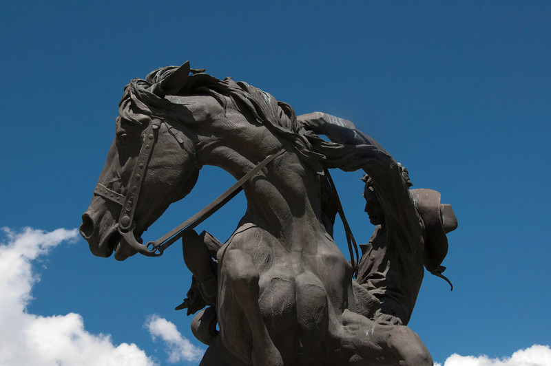 This very detailed life size statue is located on the capitol grounds in Cheyenne, Wyoming. I was framing the shot and noticed the clouds moving in. I waited till they were close to the horse's nose for the final effect.