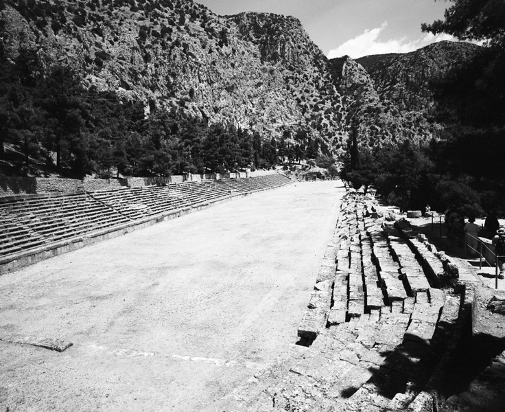 The ancient stadium at Delphi in Greece is carved into the hill underneath Mount Parnassus. (Scanned from black and white film.)