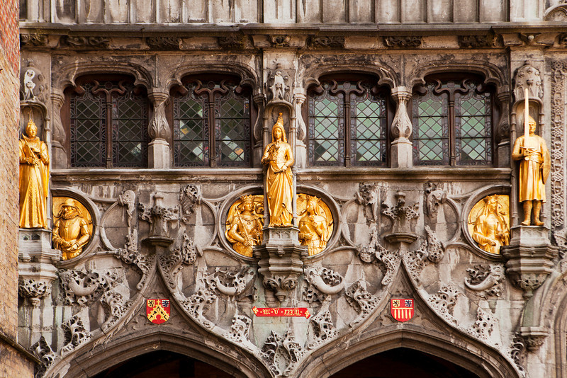 Gilded stone statues decorate the entrance over the doors to the Basilius, or Basilica of the Holy Blood, in Bruges, Belgium.