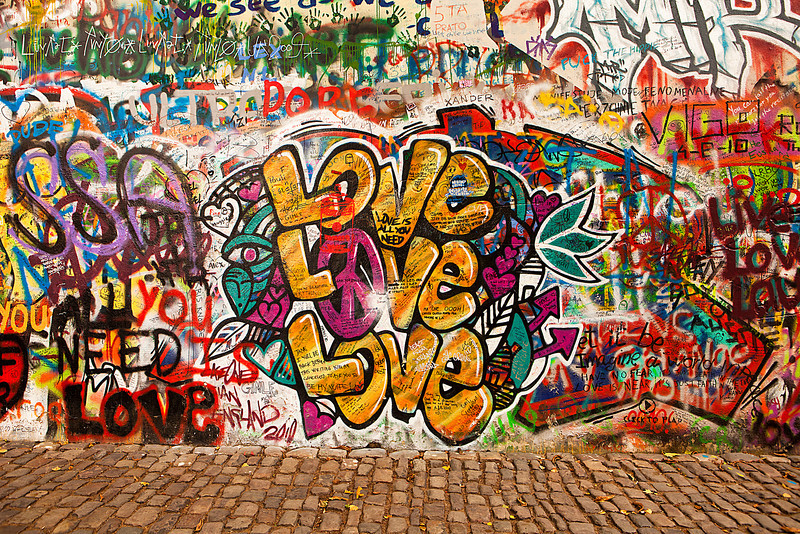 Prague, Czech Republic - October 7, 2010: A section of the Lennon Wall in the Little Town area of Prague near the Charles Bridge. This landmark wall is open to public graffiti in remembrance of John Lennon.