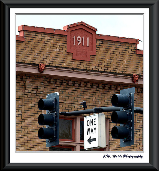 Ages apart - Traffic signal and old building in downtown Hillsboro, Oregon