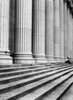A single man sitting on the steps of the main entrance to the New York City Post Office illustrates how small a man relative to the pillars in the front facade. (Scanned from black and white film.)