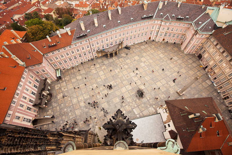 A bird's eye view of the main courtyard at the Prague Castle. Taken from 150 feet up in the belltower of St. Vitus cathedral, details of the tower, various palaces, and government offices are all visible.