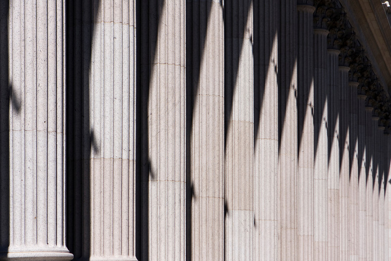 A row of ionic stone columns, or colonnade, creates a classical entrance to the US Post Office in New York City.