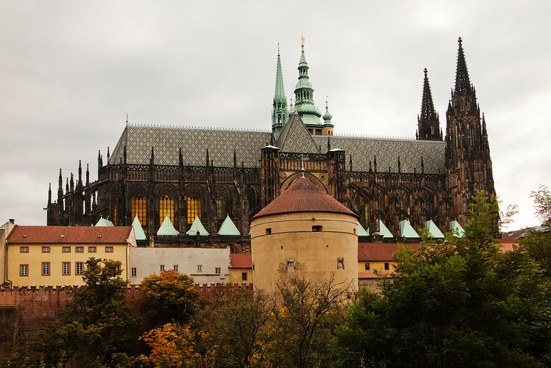 The Gothic-style Cathedral of St. Vitus is a historic landmark in Prague and is part of the Prague Castle. This view is from the back side of the castle and is seen across a deep gorge.