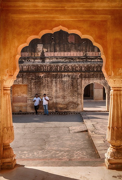 Two Men Via An Arch Of The Man Singh Palace