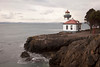 The lighthouse at Lime Kiln Point State Park on San Juan Island. The building looks out over the waters of Puget Sound.