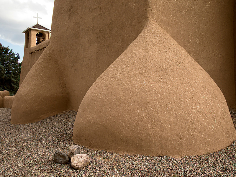 San Francisco de Asis Mission Church is a historic landmark in the Rancho de Taos area of New Mexico. The traditional adobe structure was built in the 1700s and has large rounded ramparts.