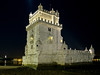 Viewed at night, Belem Tower, or the Tower of St. Vincent, was the starting point for many voyages of discovery. Built in 1515 as a fortress to guard Lisbon's harbor, it is a symbol of Portugal and the Age of Discovery, and is a UNESCO World Heritage monument.