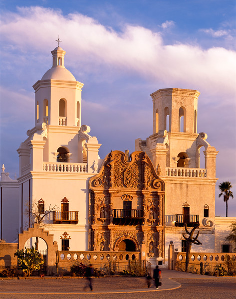 People rushing in to service at San Xavier, South of Tucson.  A long term renovation project is underway and the tower on the left has already been re-finished.