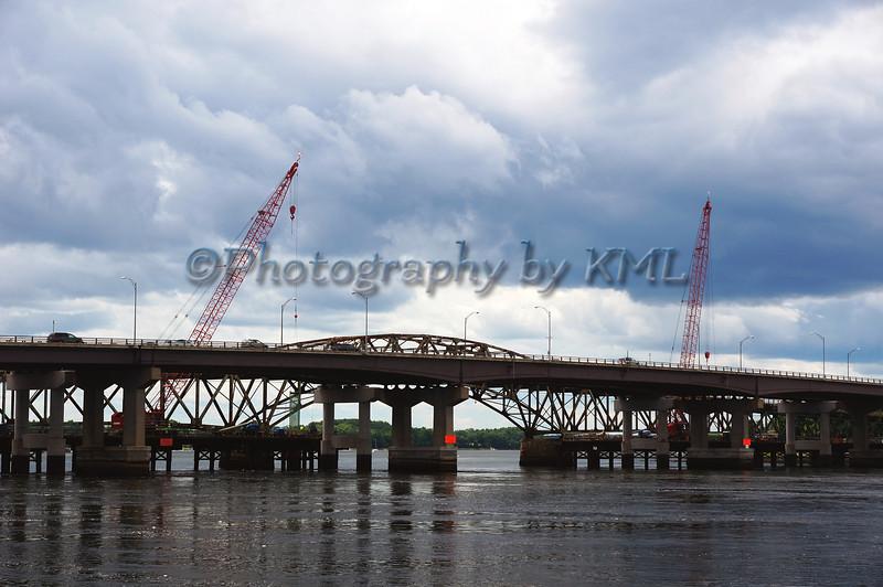 Cranes Fixing the Bridge
