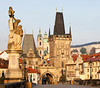 A view of the Charles Bridge landmark looking towards Lesser Town with the bridgetower in the foreground and Prague Castle in the background.