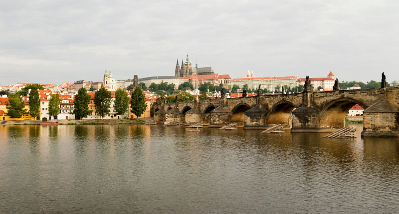 A panorama view of the main castle (Hradcany) in Prague and the Charles Bridge over the Voltava River.