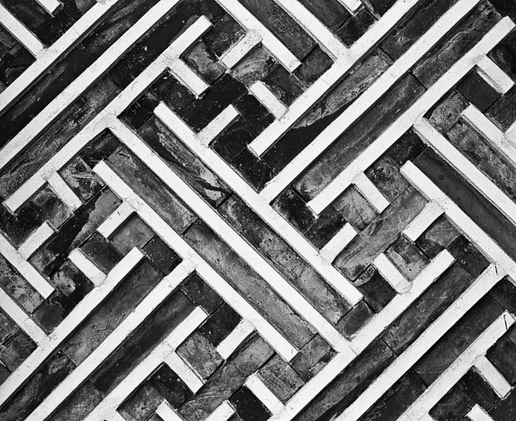 A portion of the geometric pattern provides decoration for one of the walls in the Gyeonbok Imperial Palace in Seoul, South Korea. The diagonal lines repeat throughout the wall. (Scanned from black and white film.)