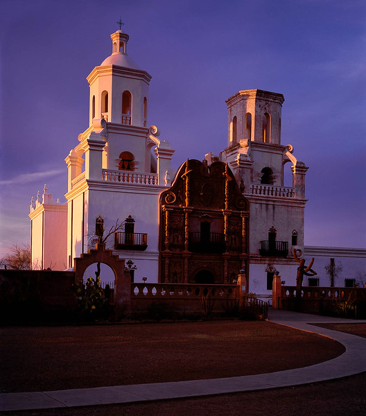 A photograph of San Xavier at sunset.  The mission, just South of Tucson still holds services.