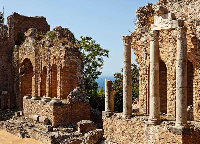 The ruins of the ancient Roman theatre, or Teatro Antico, in Taormina, Italy still stand and the main walls, or edificio sceneo, are still in good condition. The theater is still used for modern performances.